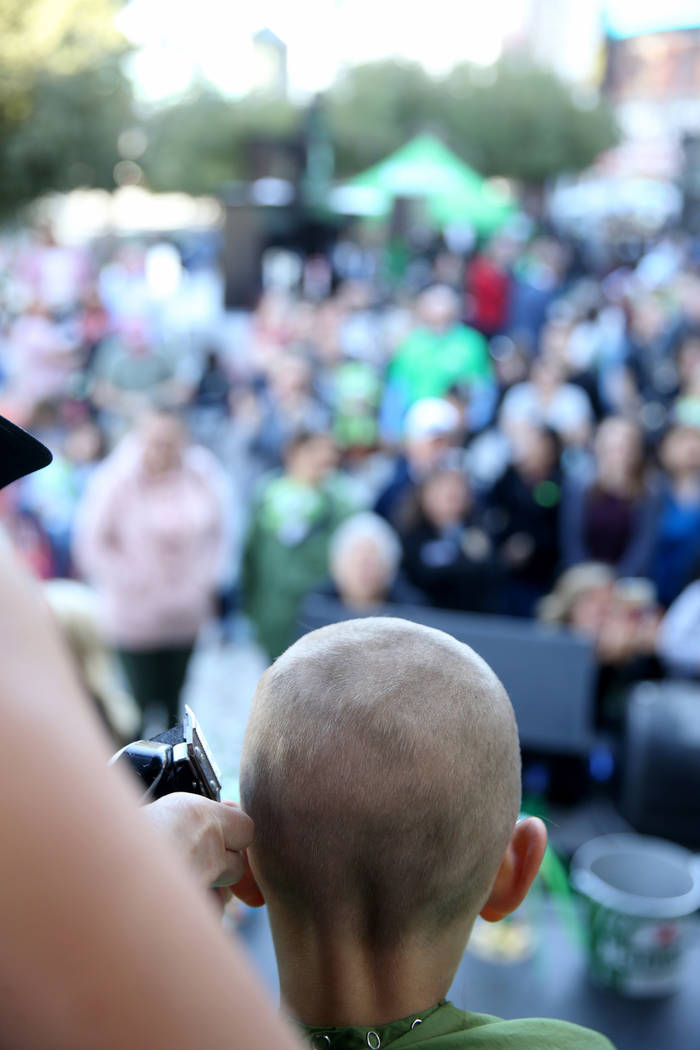 Dylan Foote, 8, of Las Vegas gets his head shaved during St. Baldrick's Foundation shave-a-thon on the Brooklyn Bridge at New York-New York in Las Vegas, Saturday, March 9, 2019. (K.M. Cannon/Las ...