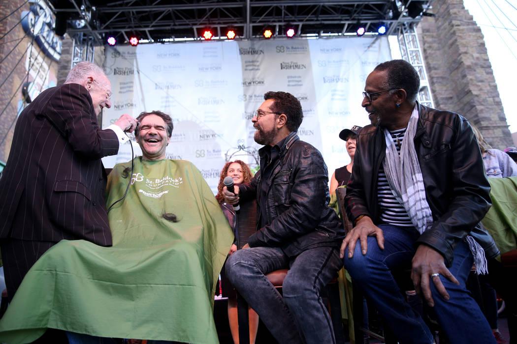 Las Vegas Review-Journal man-about-town columnist John Katsilometes gets his head shaved by former Las Vegas Mayor Oscar Goodman during St. Baldrick's Foundation shave-a-thon on the Brooklyn Bridg ...