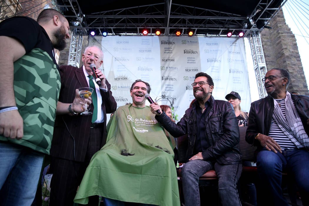 Las Vegas Review-Journal man-about-town columnist John Katsilometes gets his head shaved by former Las Vegas Mayor Oscar Goodman during St. Baldrick's Foundation shave-a-thon on the Brooklyn Bridg ...
