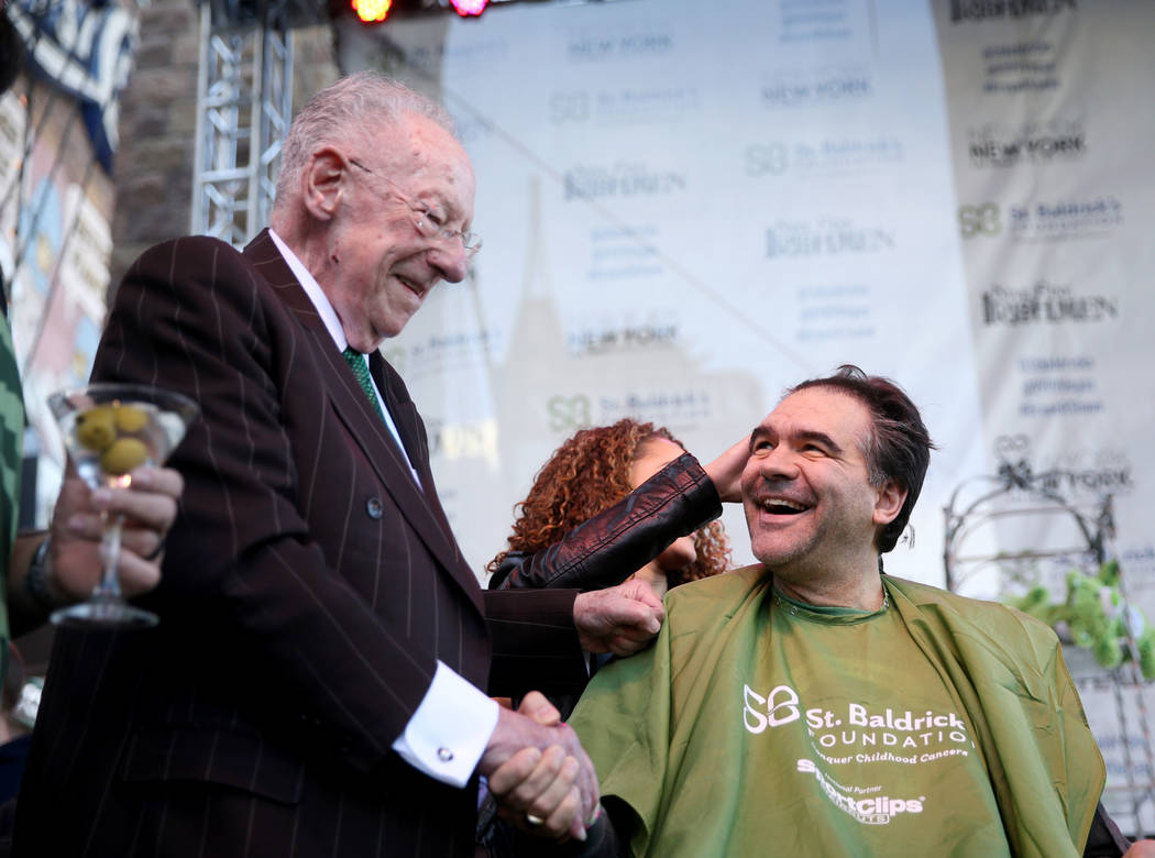 Las Vegas Review-Journal man-about-town columnist John Katsilometes thanks former Las Vegas Mayor Oscar Goodman during St. Baldrick's Foundation shave-a-thon on the Brooklyn Bridge at New York-New ...