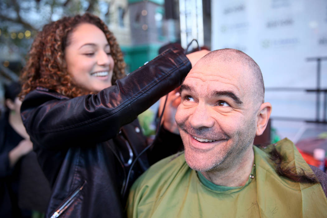 Las Vegas Review-Journal man-about-town columnist John Katsilometes gets his head shaved by Brianna Brown during St. Baldrick's Foundation shave-a-thon on the Brooklyn Bridge at New York-New York ...