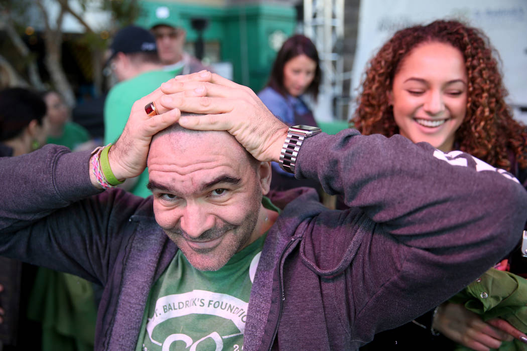 Las Vegas Review-Journal man-about-town columnist John Katsilometes after getting his head shaved by Brianna Brown during St. Baldrick's Foundation shave-a-thon on the Brooklyn Bridge at New York- ...