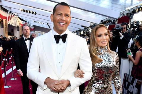 Alex Rodriguez, left, and Jennifer Lopez arrive at the Oscars at the Dolby Theatre in Los Angeles in February 2019. (Photo by Charles Sykes/Invision/AP)