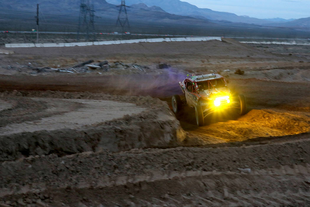 Racer number 2910 (Team: Brett Comiskey (50) and Rock Hampton, of British Columbia) competes in the annual Mint 400 on Saturday, March 09, 2019, at Primm Valley Resort, outside Las Vegas. Four-whe ...