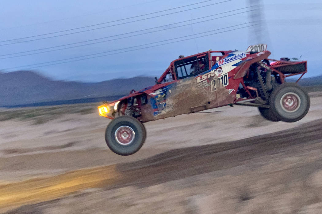 Racer number 2910 (Team: Brett Comiskey (50) and Rock Hampton of British Columbia) competes in the annual Mint 400 on Saturday, March 09, 2019, at Primm Valley Resort, outside Las Vegas. Four-whee ...