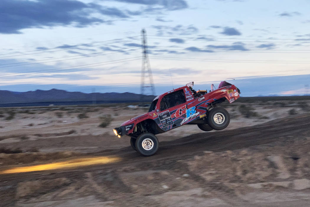 Racer number 6012 (Team: Greg Bragg (51) Visalia, Calf., Nick Chivello (25) Manteca, Calf. and Jim Neville (55) Mission Viejo, Calf.) takes a jump in the annual Mint 400 on Saturday, March 09, 201 ...