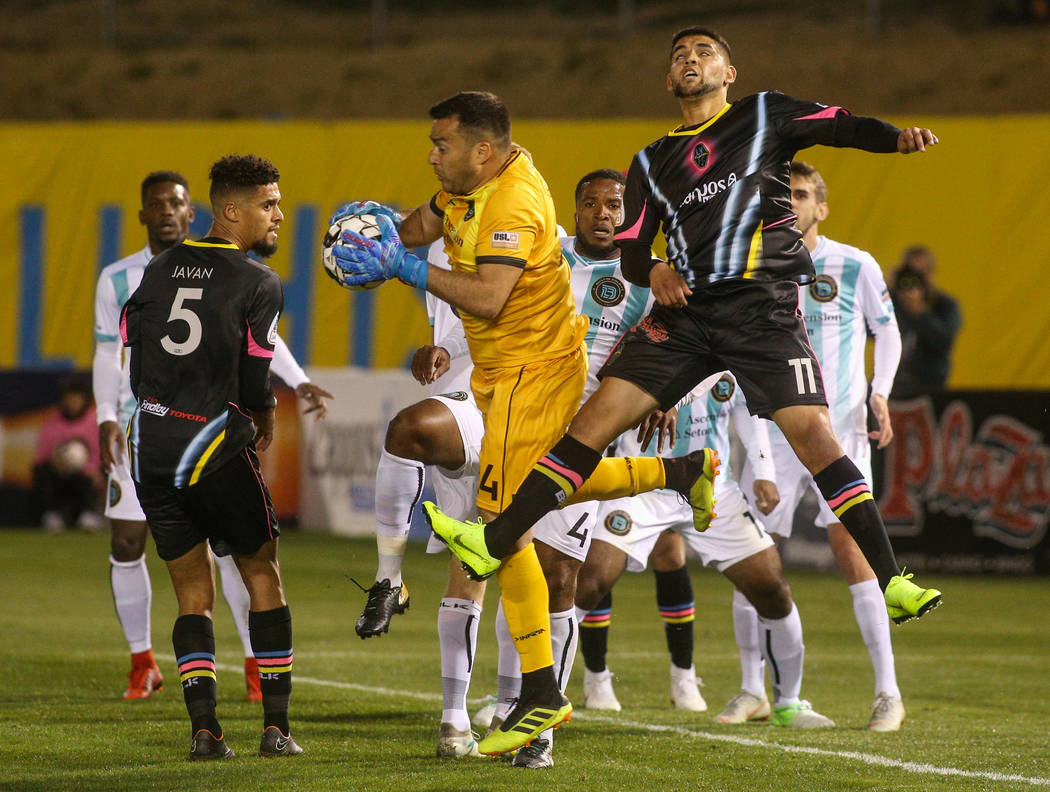 Austin Bold FC goalkeeper Diego Restrepo (24) grabs the ball after a corner kick is taken by the Las Vegas Lights FC during the first half of a United Soccer League match at Cashman Field in Las V ...
