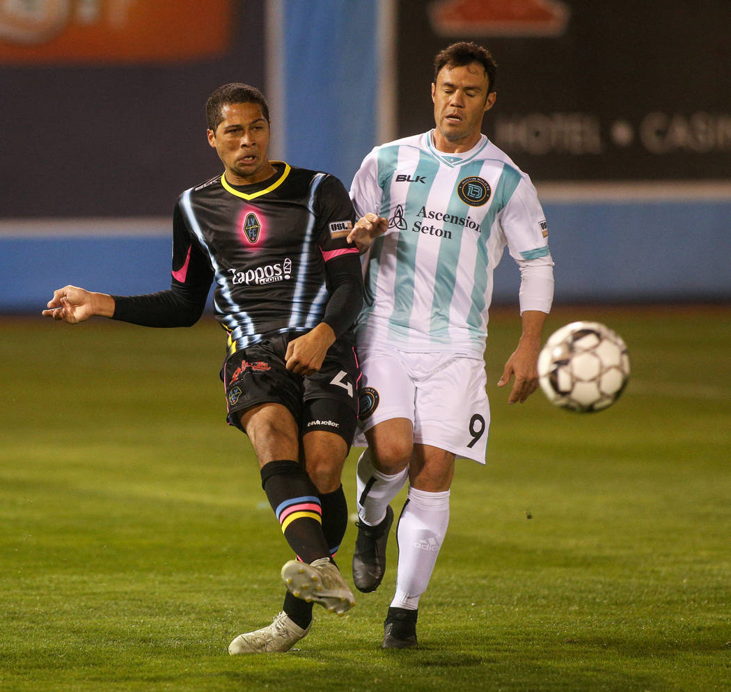 Las Vegas Lights FC defender Gabe Robinson (4) passes to a teammate while being guarded by Austin Bold FC forward Kleber Giacomazzi (9) during the first half of a United Soccer League match at Cas ...