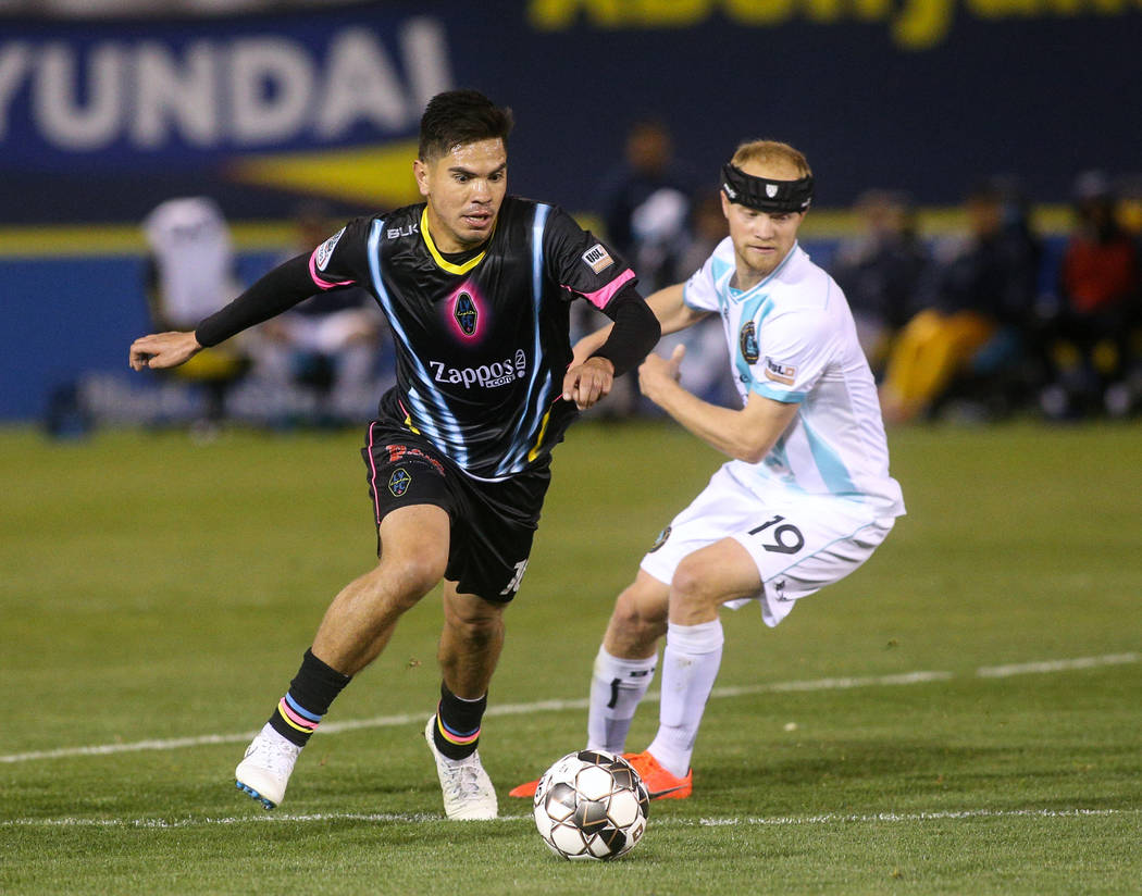 Las Vegas Lights FC midfielder Cristhian Hernandez (10) moves with the ball past Austin Bold FC forward Kris Tyrpak (19) during the first half of a United Soccer League match at Cashman Field in L ...