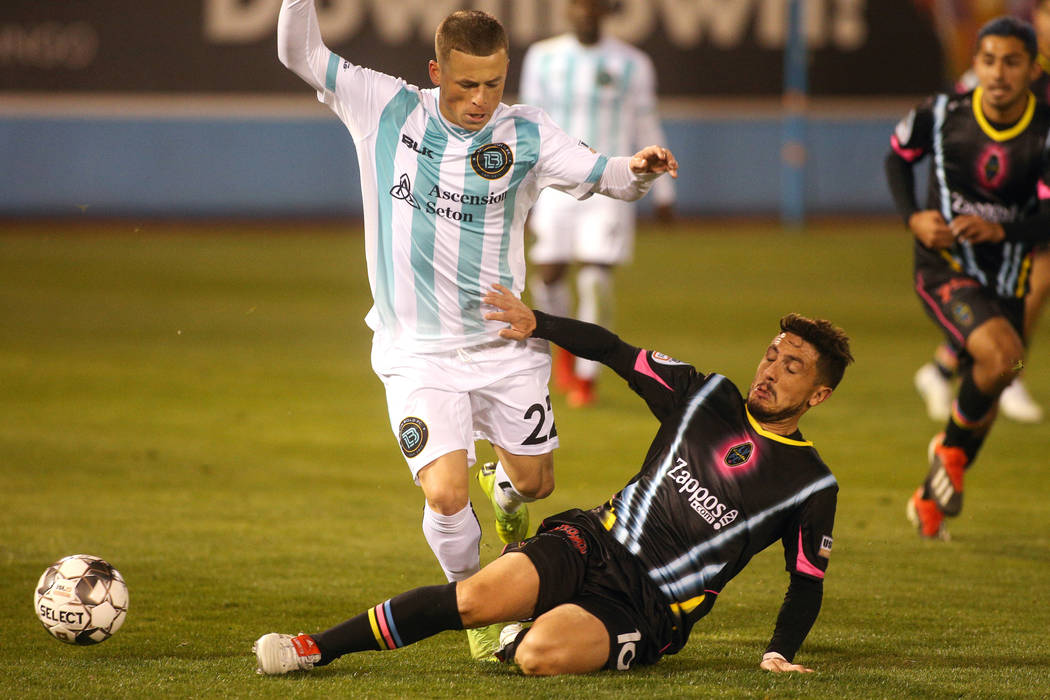 Las Vegas Lights FC midfileder Lucas Scaglia (16) slides into Austin Bold FC forward Clayton Adams (22) for the ball during the second half of a United Soccer League match at Cashman Field in Las ...