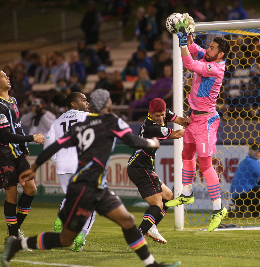 Las Vegas Lights FC goalkeeper Thomas Olsen (1) stops the ball in front of the goal during the second half of a United Soccer League match at Cashman Field in Las Vegas, Saturday, March 9, 2019. ( ...
