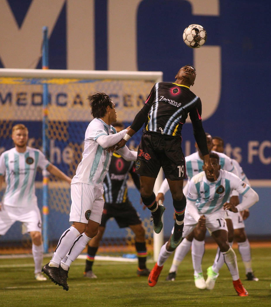 Las Vegas Lights FC forward Tabort Etaka Preston (19) jumps up to head the ball during the second half of a United Soccer League match at Cashman Field in Las Vegas, Saturday, March 9, 2019. (Caro ...