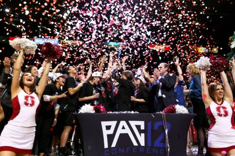 The Stanford Cardinals celebrate after defeating the Oregon Ducks during a NCAA college basketball game in the final of the Pac-12 women's tournament at the MGM Grand Garden Arena in Las Vegas, Su ...
