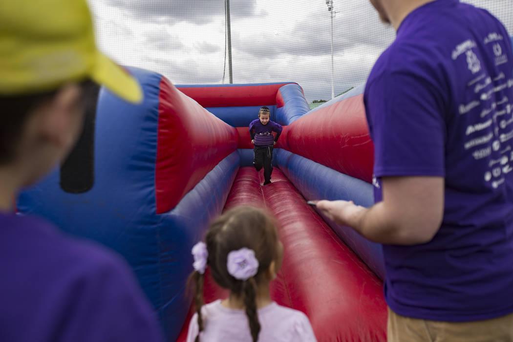 Yossi Chanya Goldblatt, 9, runs in a bouncy ride during Friendship Circle'sWalk4FriendshipLasVegas eventat Las Vegas Sports Park, Sunday, March 10, 2019. Friendship Circle ...