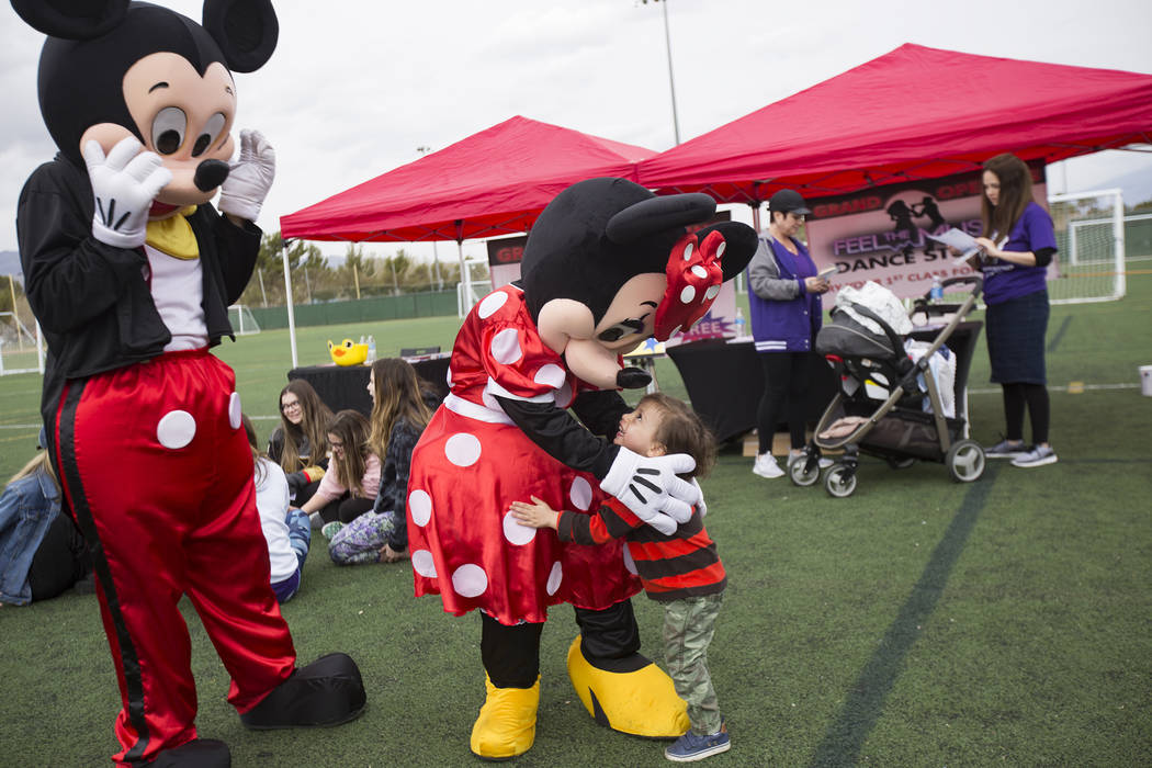 Minnie Mouse hugs Barack Sharaby, 2, during Friendship Circle'sWalk4FriendshipLasVegas event, Sunday, March 10, 2019, at Las Vegas Sports Park. Friendship Circle is a nonsectaria ...