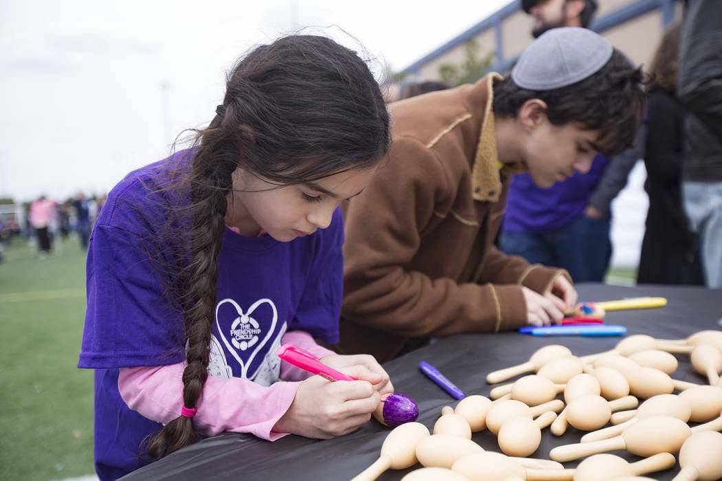 Emma Kellman, 10, colors maracas with her brother Aaron Kellman, 10, at Las Vegas Sports Park as part of Friendship Circle's Walk for Friendship event in Las Vegas, Sunday, March 10, 2019. Friends ...