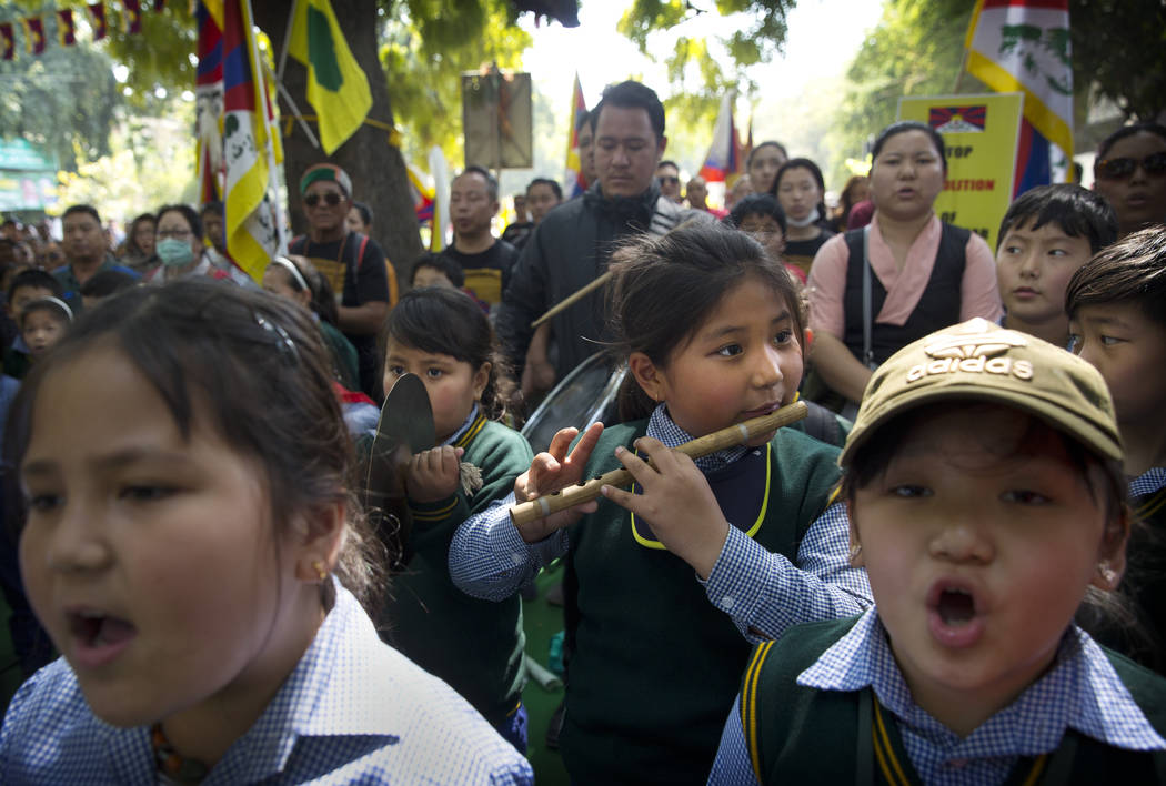 Tibetan school children sing their national anthem at the end of a march to mark the 60th anniversary of the March 10, 1959 Tibetan Uprising Day, in New Delhi, India, Sunday, March 10, 2019. The u ...