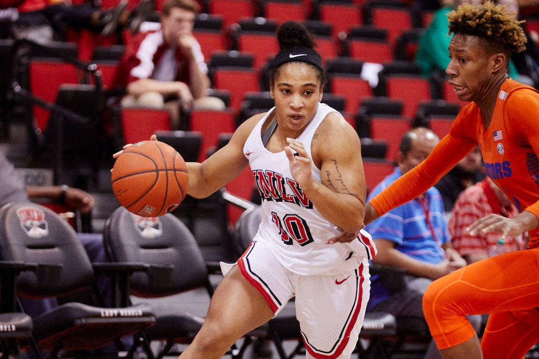 UNLV point guard Nikki Wheatley in action against Florida on Dec. 21 at Cox Pavilion. Courtesy of UNLV Photo Services.