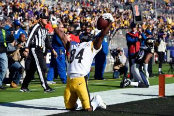 Antonio Brown celebrates after scoring a touchdown in the first half of an NFL football game against the Baltimore Ravens, Sunday, Nov. 4, 2018, in Baltimore. (AP Photo/Gail Burton)