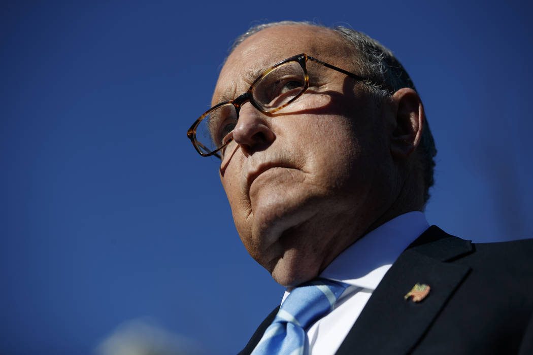 FILE- In this Dec. 3, 2018, file photo White House chief economic adviser Larry Kudlow talks with reporters about trade negotiations with China, at the White House in Washington. President Donald ...