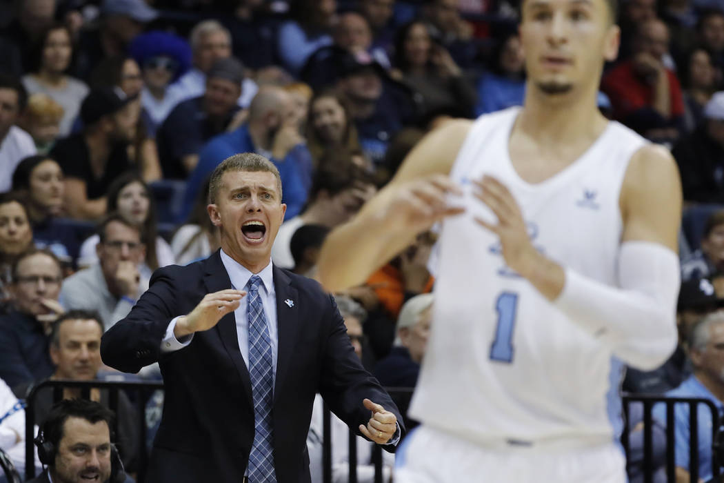 San Diego coach Sam Scholl, left, reacts during the first half of the team's NCAA college basketball game against Gonzaga, Saturday, Feb. 16, 2019, in San Diego. (AP Photo/Gregory Bull)