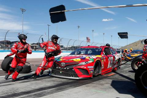 Driver Kyle Busch makes a pit stop on lap 153 during the NASCAR Cup Series auto race at ISM Raceway, Sunday, March 10, 2019, in Avondale, Ariz. (AP Photo/Ralph Freso)