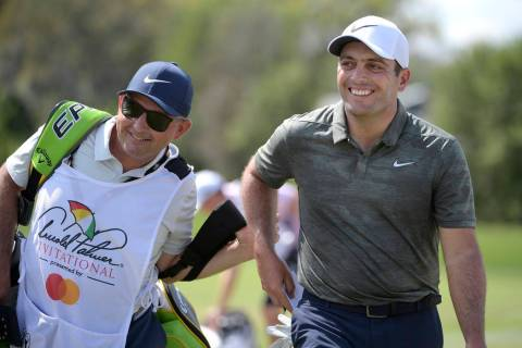 Francesco Molinari, right, of Italy, leaves the first green after making a putt for birdie during the final round of the Arnold Palmer Invitational golf tournament Sunday, March 10, 2019, in Orlan ...