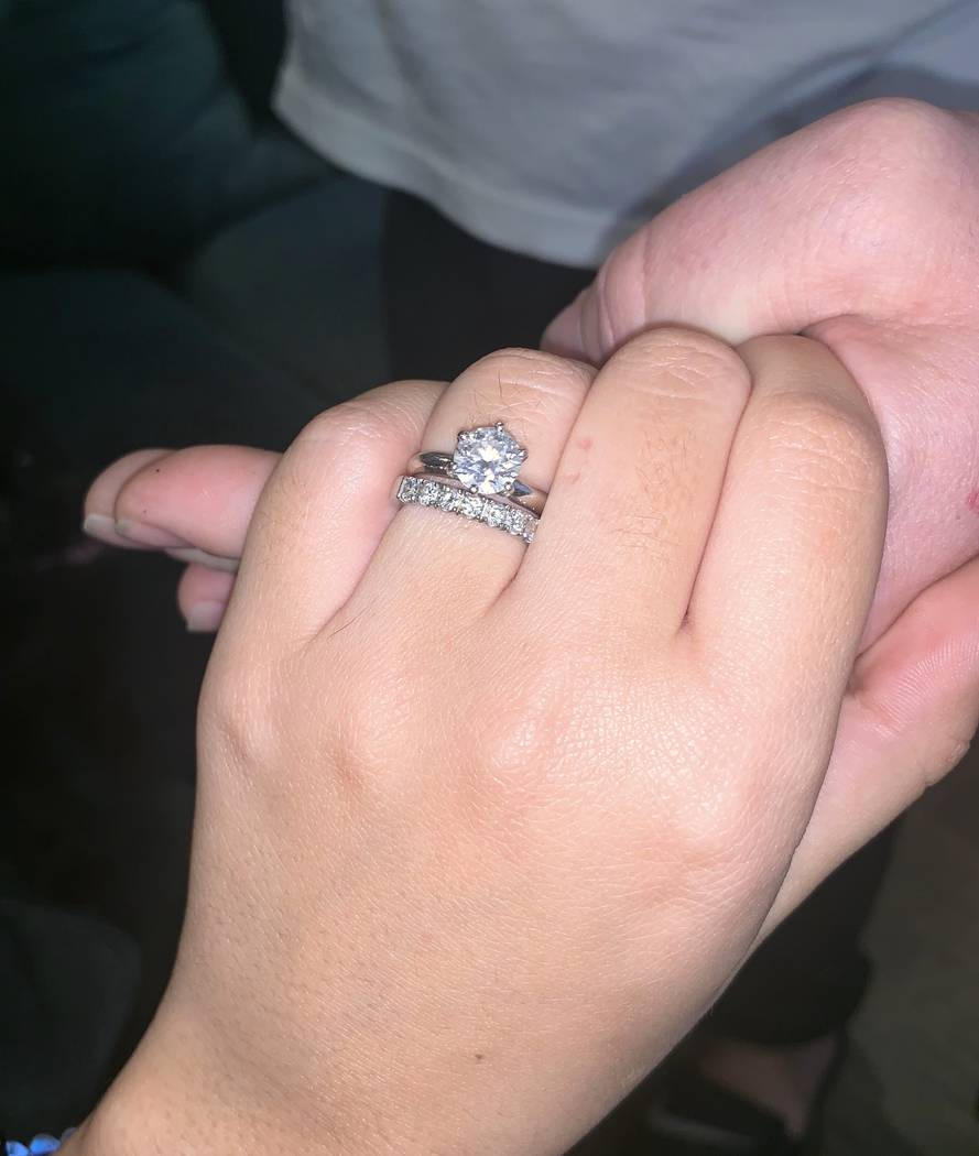 "Olivia Rademann shows her 1.5-karat wedding band. She and Austin ""Chumlee"" Russell are to be legally married in May in Hawaii. (Austin Russell)"