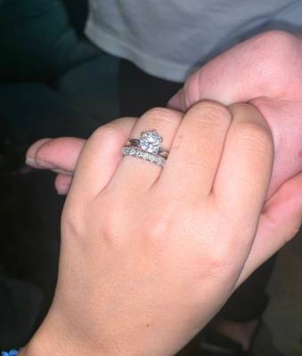 """Olivia Rademann shows her 1.5-karat wedding band. She and Austin """"Chumlee"""" Russell are to be legally married in May in Hawaii. (Austin Russell)"""