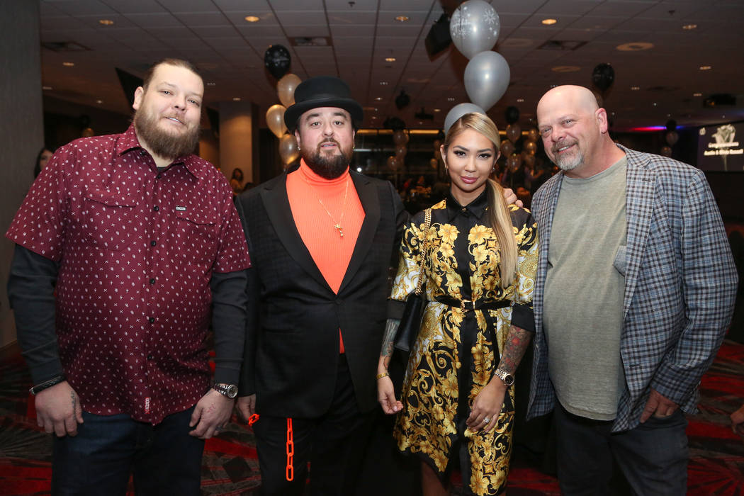 """Pawn Stars"" co-star Austin ""Chumlee"" Russell and his fiancee, Olivia Rademann, are shown with Corey Harrison, far left, and Rick Harrison at the couple's pre-wedding ceremony and party at the D L ..."