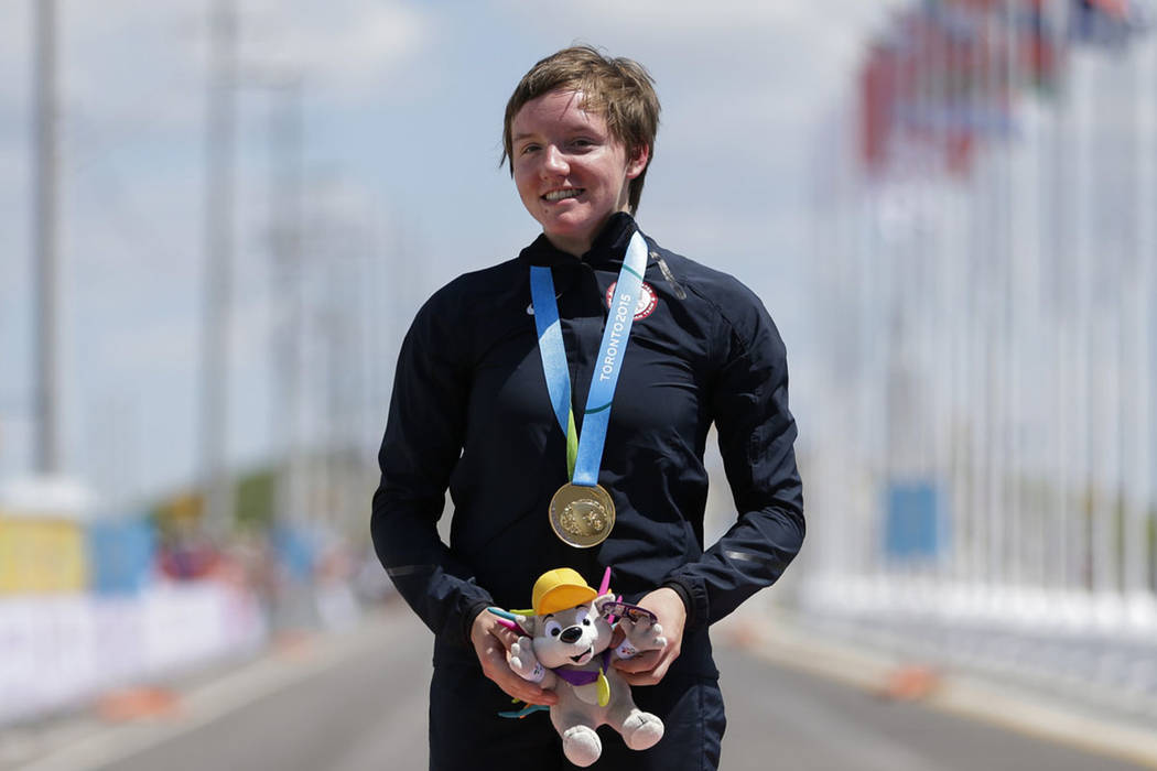 United States gold medalist Kelly Catlin poses after winning the women's individual time trial cycling competition at the Pan Am Games in Milton, Ontario, in 2015. (AP Photo/Felipe Dana)