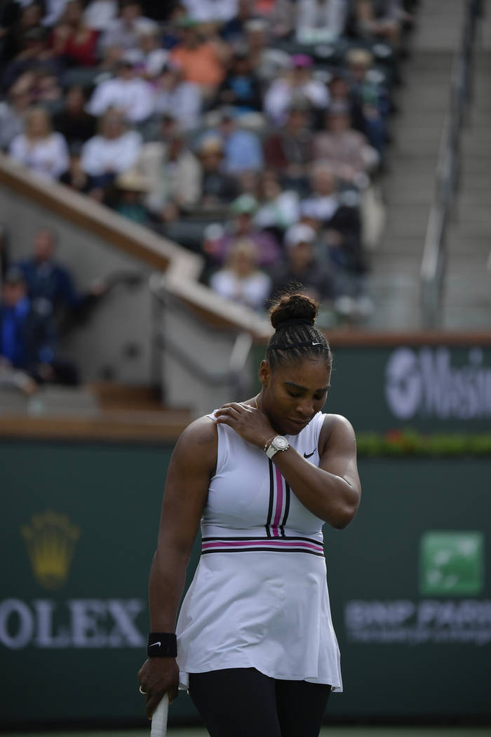 Serena Williams reacts during a match against Garbine Muguruza, of Spain, at the BNP Paribas Open tennis tournament Sunday, March 10, 2019, in Indian Wells, Calif. Williams retired from the match ...