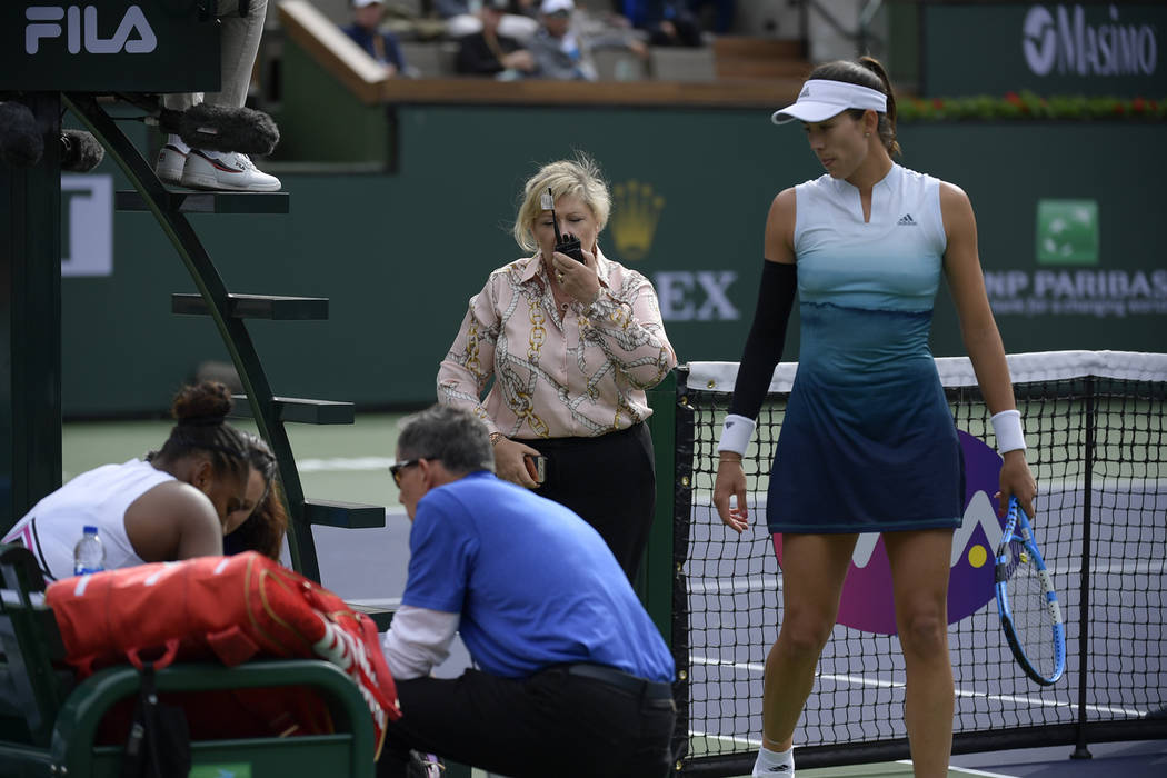 Garbine Muguruza, of Spain, right, looks towards Serena Williams, left, during their match at the BNP Paribas Open tennis tournament Sunday, March 10, 2019, in Indian Wells, Calif. WTA supervisor ...