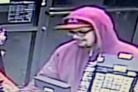 Las Vegas police want help finding a man they said robbed a business in the south valley in February. (LVMPD)