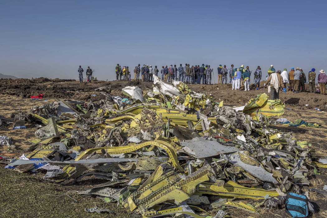 Wreckage is piled at the crash scene of an Ethiopian Airlines flight crash near Bishoftu, or Debre Zeit, south of Addis Ababa, Ethiopia, Monday, March 11, 2019. A spokesman says Ethiopian Airline ...