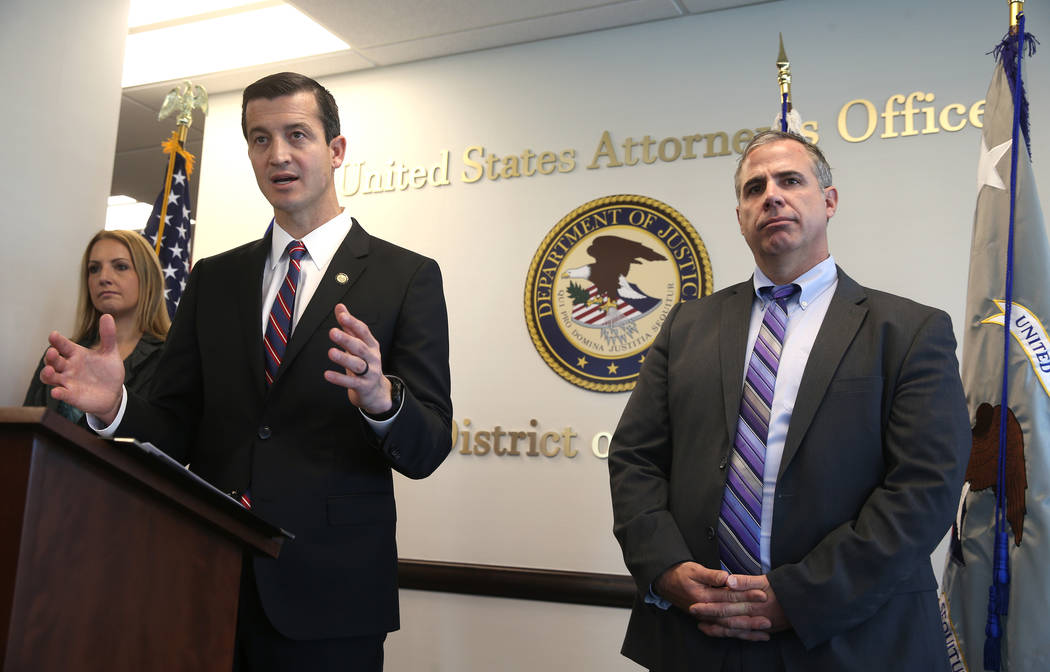 U.S. attorney Nicholas Trutanich, flanked by IRS Special Agent in Charge Tara Sullivan and FBI Assistant Special Agent in Charge Ray Johnson, during a news conference at the Federal Justice Tower ...