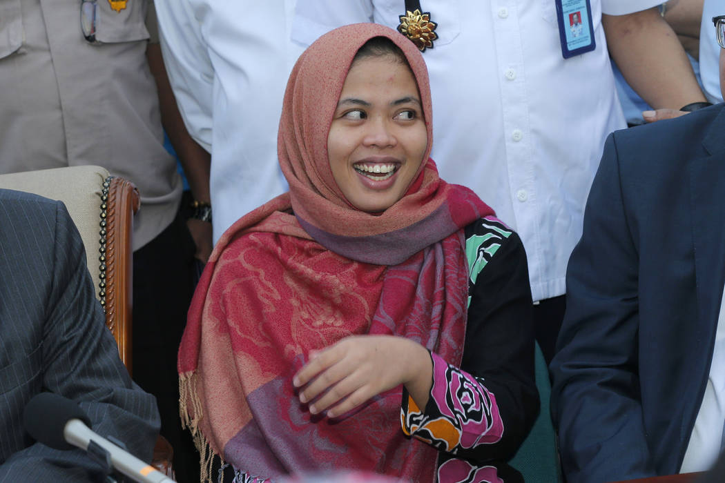 Indonesian Siti Aisyah smiles during a press conference upon returning home from Malaysia at Halim Perdanakusumah Airport in Jakarta, Indonesia, Monday, March 11, 2019. The Indonesian woman held t ...