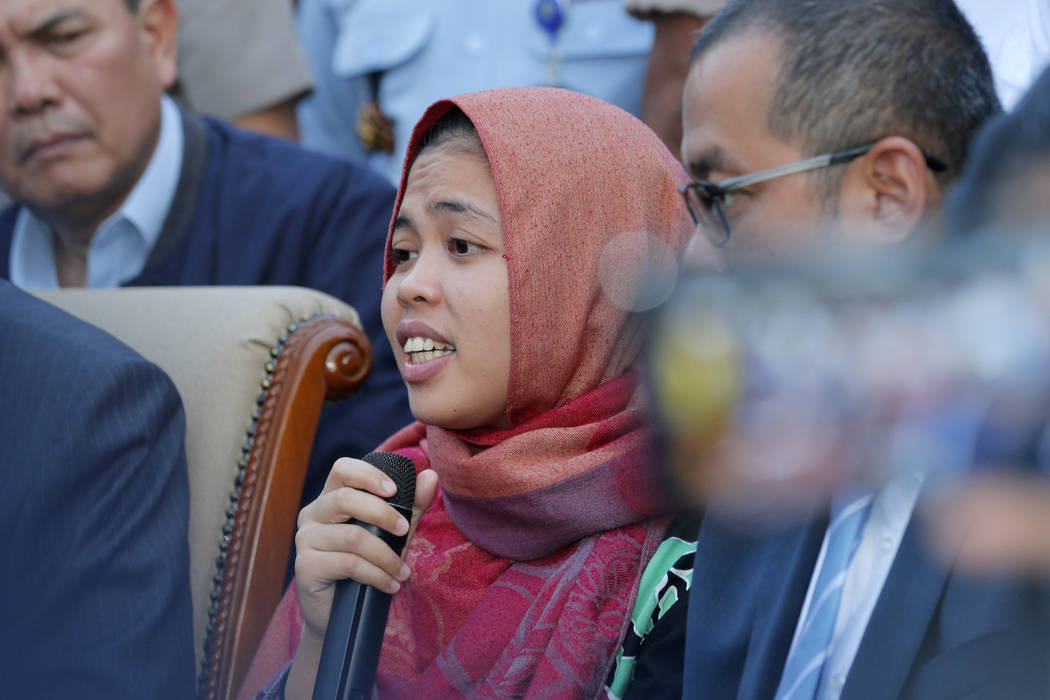 Indonesian Siti Aisyah, center, speaks during a press conference upon returning home at Halim Perdanakusumah Airport in Jakarta, Indonesia, Monday, March 11, 2019. The Indonesian woman held two ye ...