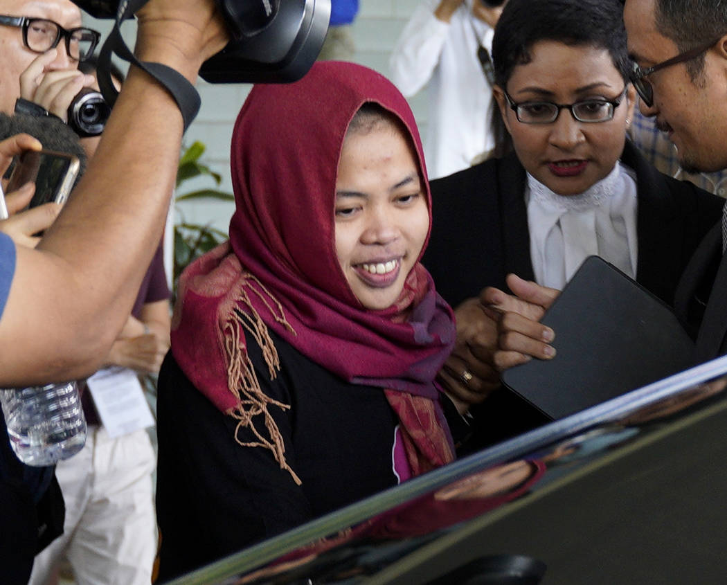 Indonesian Siti Aisyah, center, smiles as she leaves Shah Alam High Court in Shah Alam, Malaysia, Monday, March 11, 2019. The Indonesian woman held two years on suspicion of killing North Korean l ...
