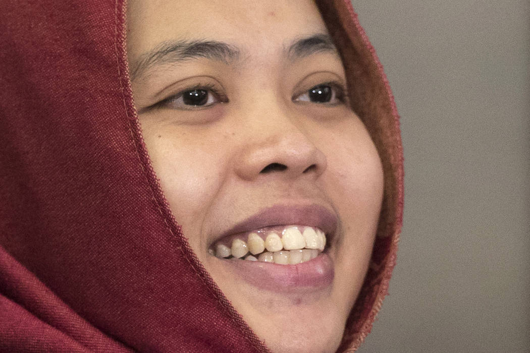 Indonesian Siti Aisyah smiles after a press conference at Indonesian Embassy in Kuala Lumpur, Malaysia, Monday, March 11, 2019. The Indonesian woman held two years on suspicion of killing North Ko ...
