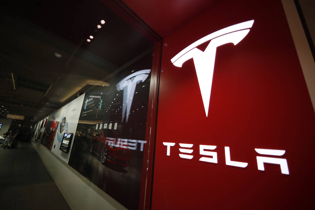 Tesla is walking back its plan to close most retail stores worldwide. The company says it still plans to move to fully online sales but it won't close as many stores as originally thought. (AP P ...