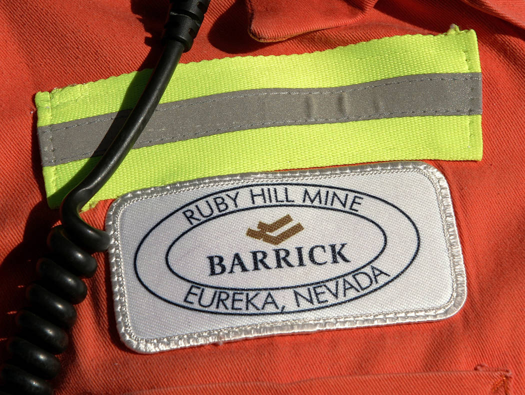 A close-up of the chest patch of a worker at Barrick's Ruby Hill Mine, outside Eureka. Barrick Gold is dropping its takeover bid for Newmont Mining, as the gold companies instead form a joint vent ...