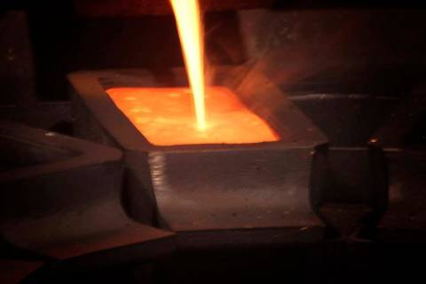 A gold pour at Barrick Gold Corp. Pipeline refinery, located about 70 miles southwest of Elko. Barrick Gold is dropping its takeover bid for Newmont Mining, as the gold companies instead form a jo ...