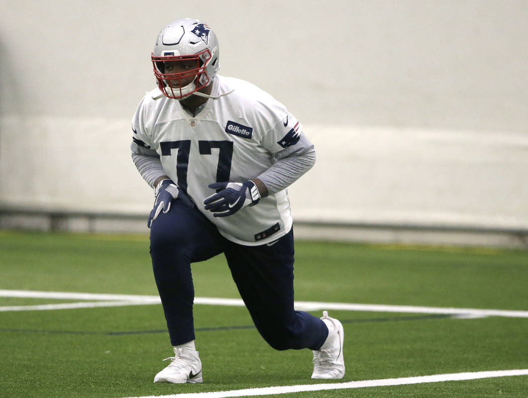 New England Patriots offensive tackle Trent Brown warms up during an NFL football practice, Thursday, Jan. 24, 2019, in Foxborough, Mass. The Los Angeles Rams are to play the New England Patriots ...