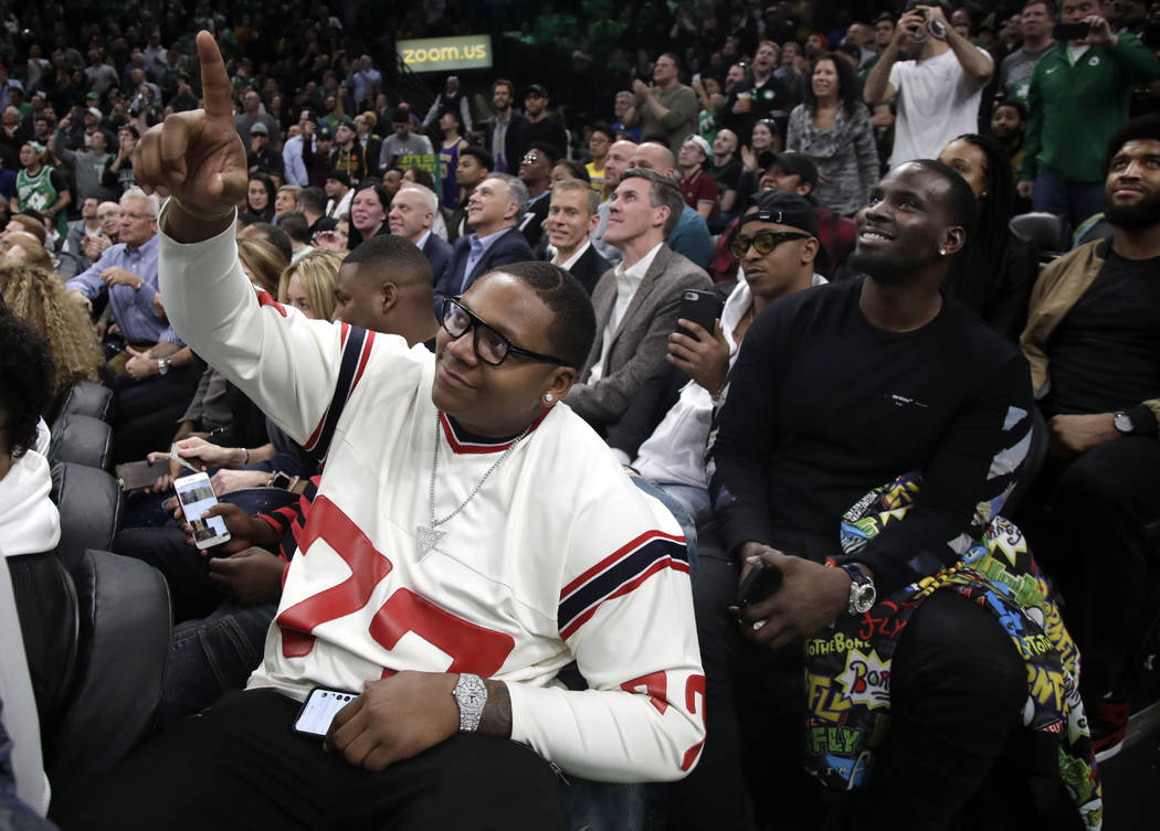 New England Patriots football player Trent Brown (77) acknowledges the fans as the Patriots' Super Bowl victory is honored during a break in an NBA basketball game between the Boston Celtics and t ...
