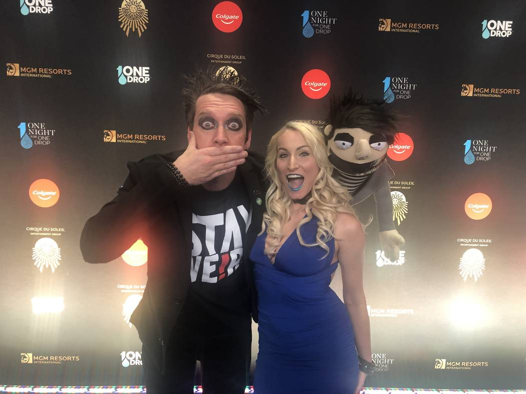 """Sam Mills, aka Tape Face at Harrah's, and Christina Balonek are shown on the Blue Carpet prior to """"One Night For One Drop,"""" held at O Theater at the Bellagio on Friday, March 8, 2019.( John Katsil ..."""