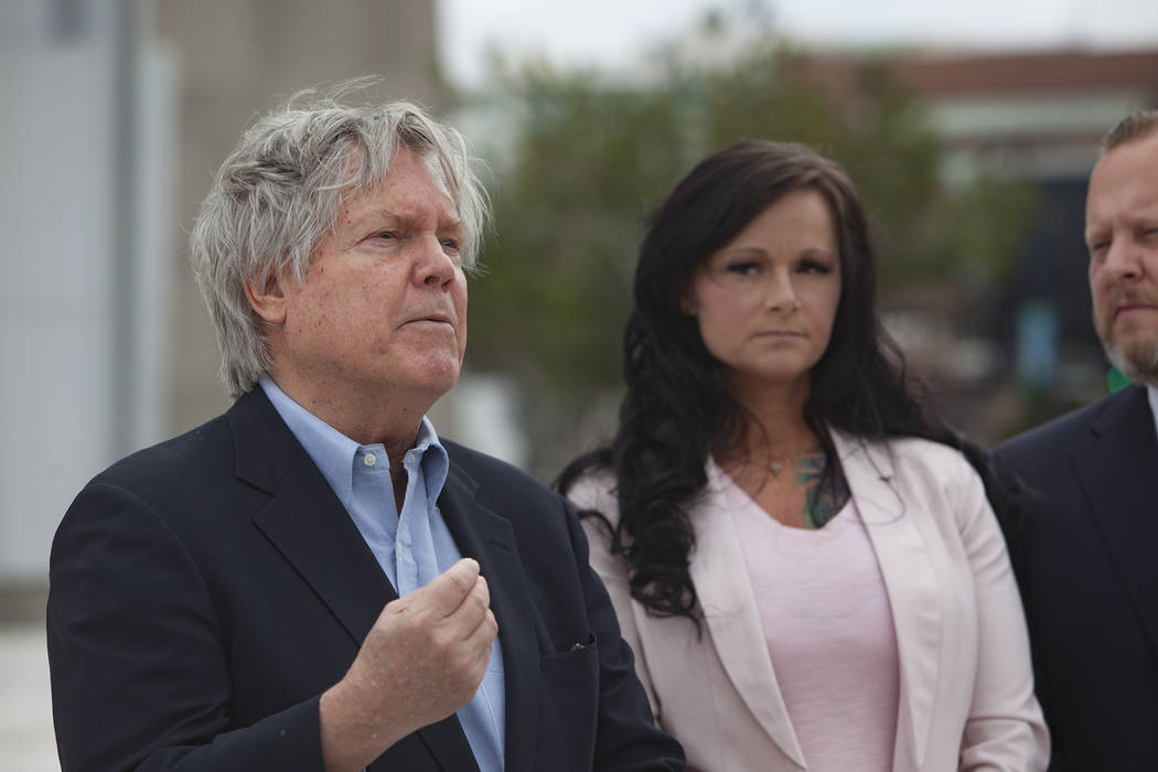 Attorney and Clark County Commissioner Tick Segerblom addresses media alongside his client Jennifer Glover outside the federal court house in Las Vegas, Monday, March 11, 2019. Glover is a former ...