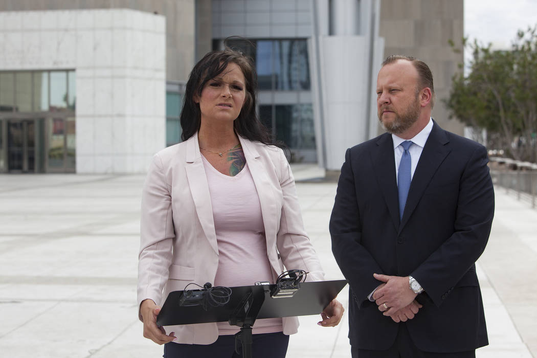 Jennifer Glover addresses the media next to her attorney Jay Ellwanger outside the federal court house in Las Vegas, Monday, March 11, 2019. Glover is a former Nevada National Security Site employ ...