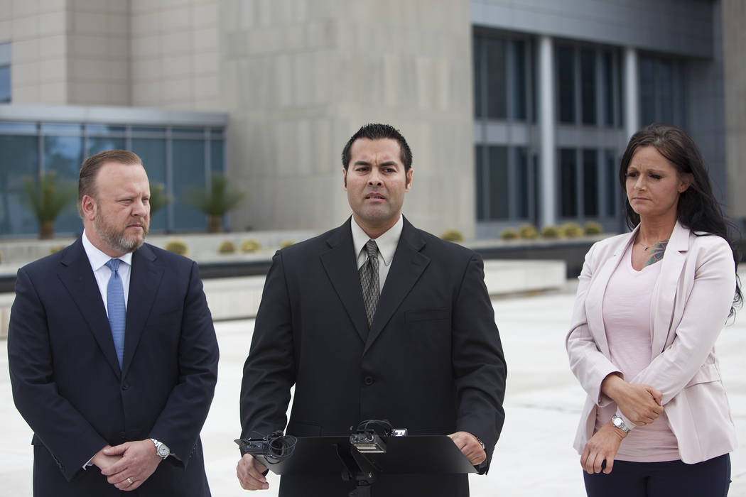 Gus Redding speaks to the media outside the federal court house in Las Vegas, Monday, March 11, 2019. Redding is a current employee at the Nevada National Security Site who alleges in a federal la ...