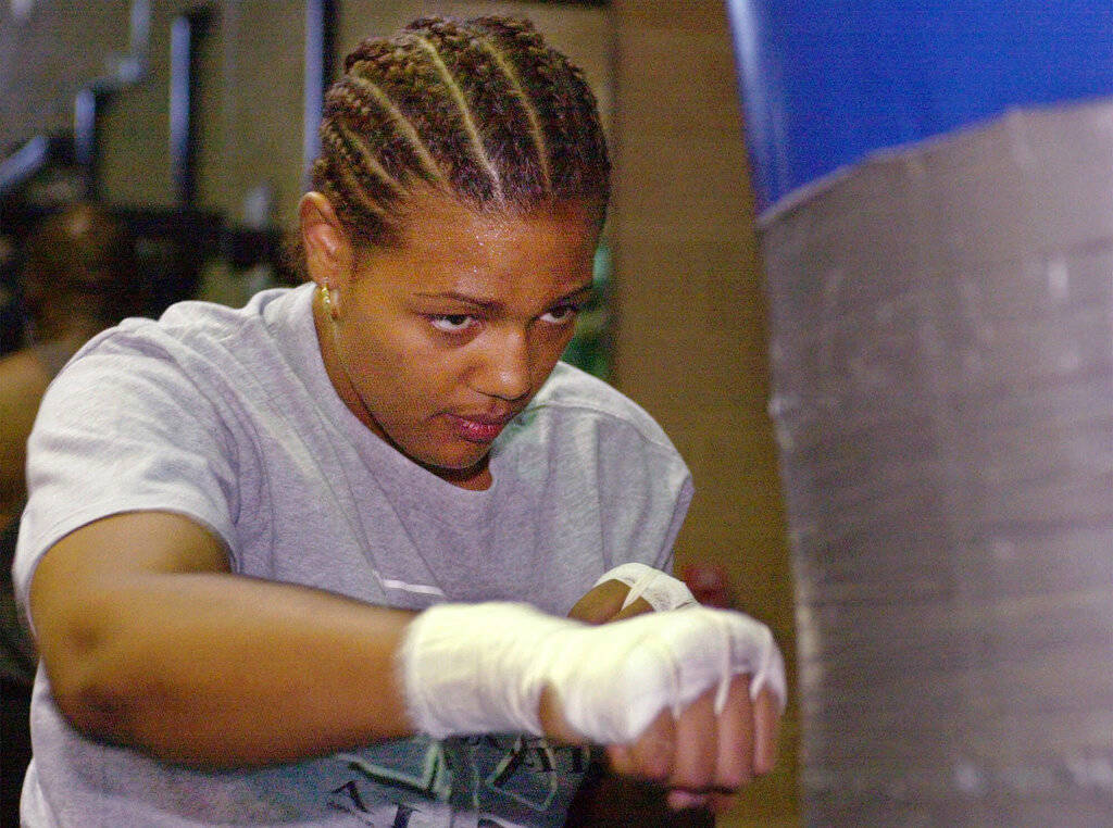 In this June 16, 2000, file photo, Freeda Foreman works out in a gym in Las Vegas. The 42-year-old daughter of former heavyweight champion George Foreman died at a Houston-area home. The Harris Co ...